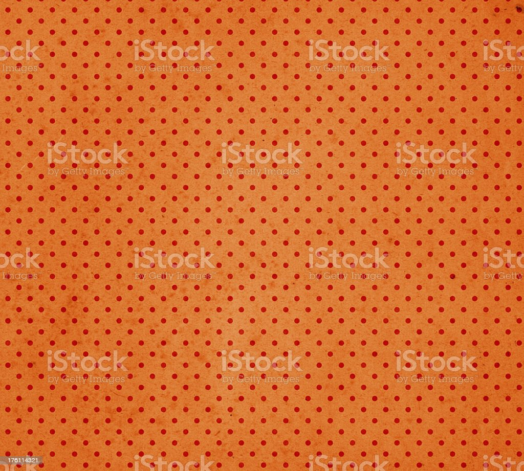 orange paper with red dots stock photo
