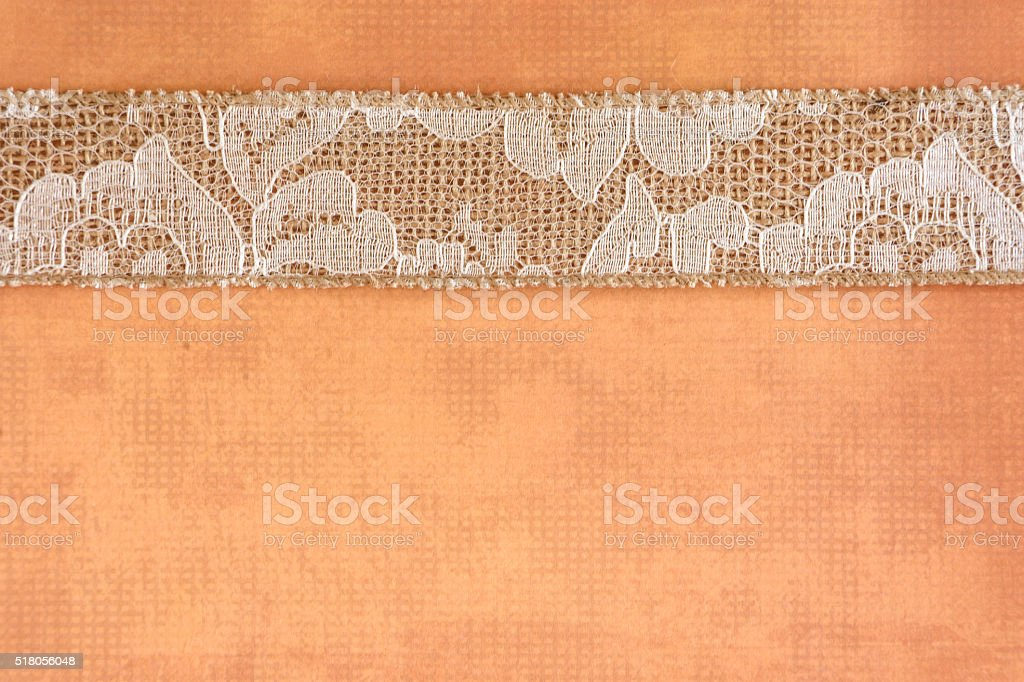 Orange Paper with White Lace and Burlap Border stock photo