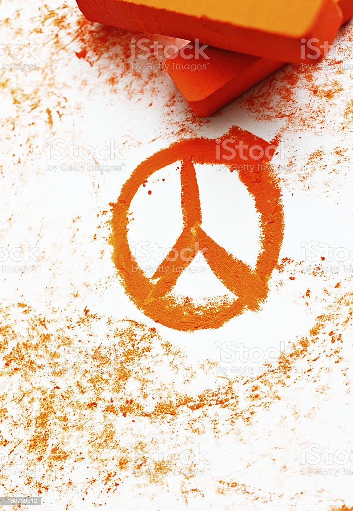 Orange pastel crayon sketch of international Peace symbol stock photo