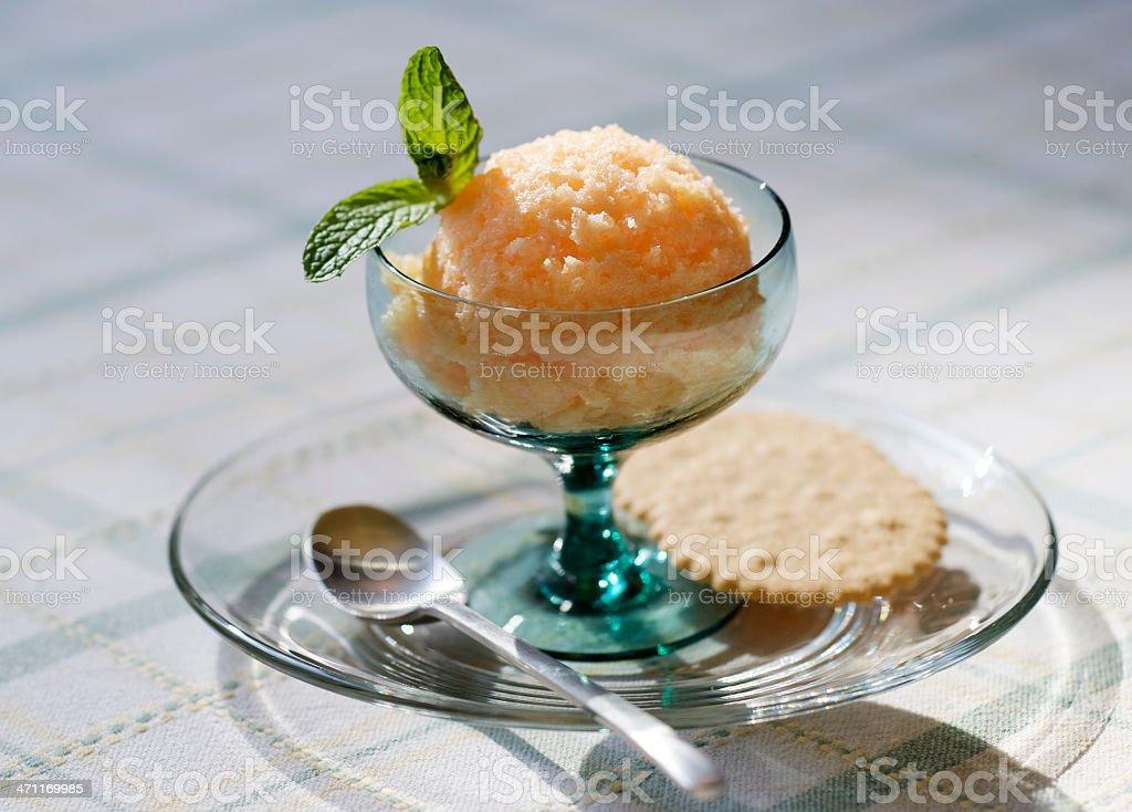 Orange Peach Sorbet in Dessert Bowl with Cookies stock photo
