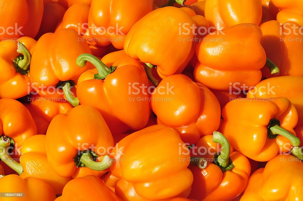 Orange peppers at a street market stock photo