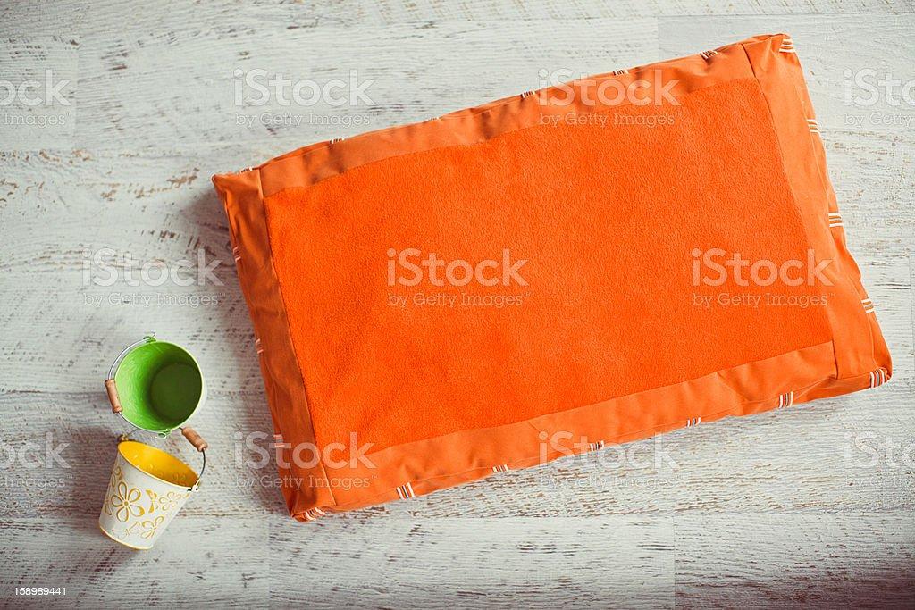 Orange pet mattress with buckets on the floor royalty-free stock photo