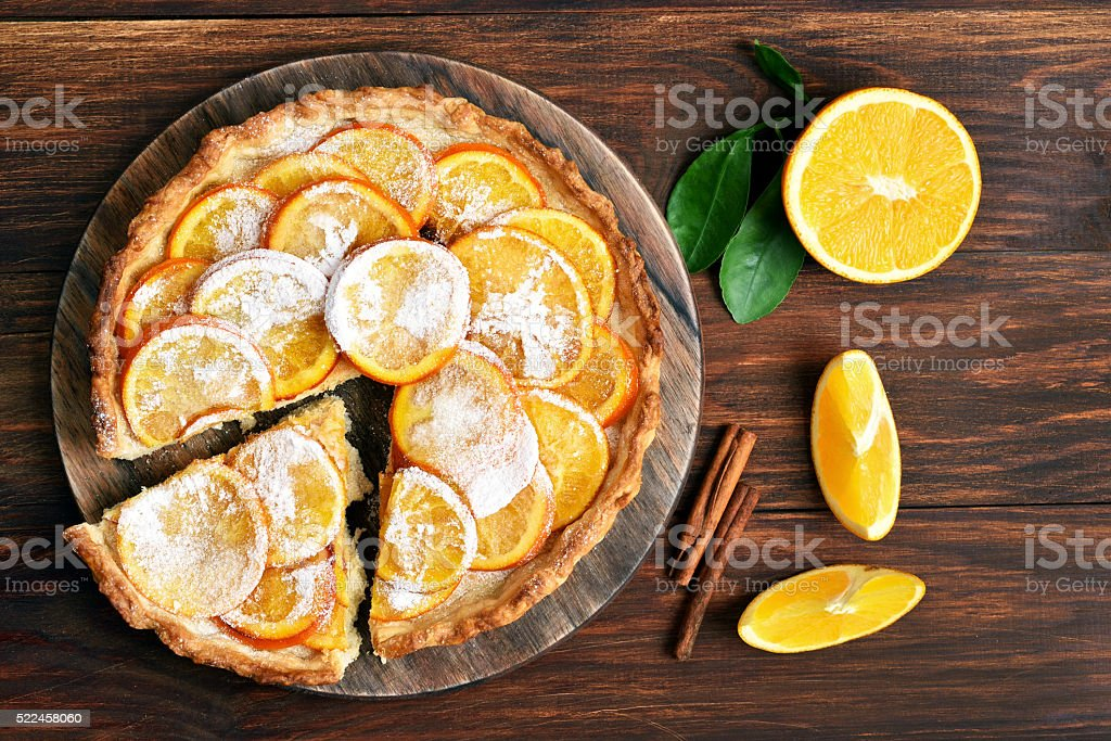 Orange pie with caramelized slices stock photo