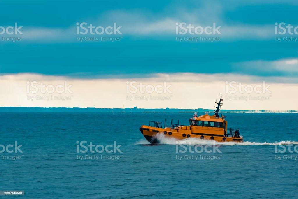 Orange pilot ship stock photo