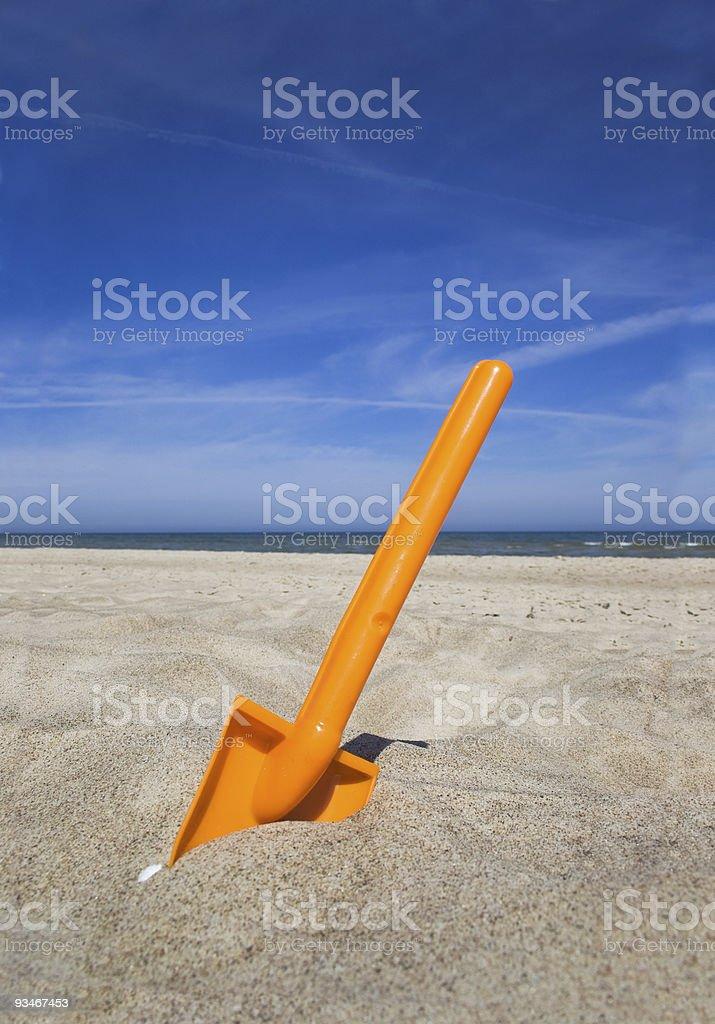 Orange plastic beache spade royalty-free stock photo