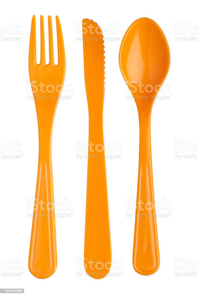 Orange plastic knife fork and spoon with paths stock photo