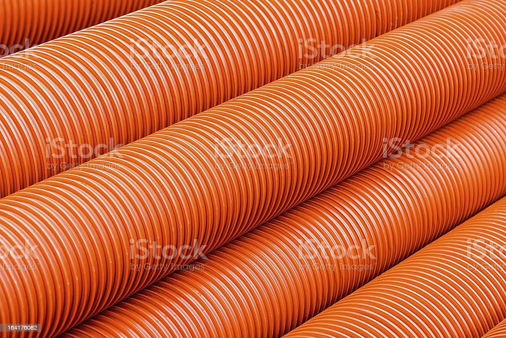 Orange plastic PVC pipes royalty-free stock photo