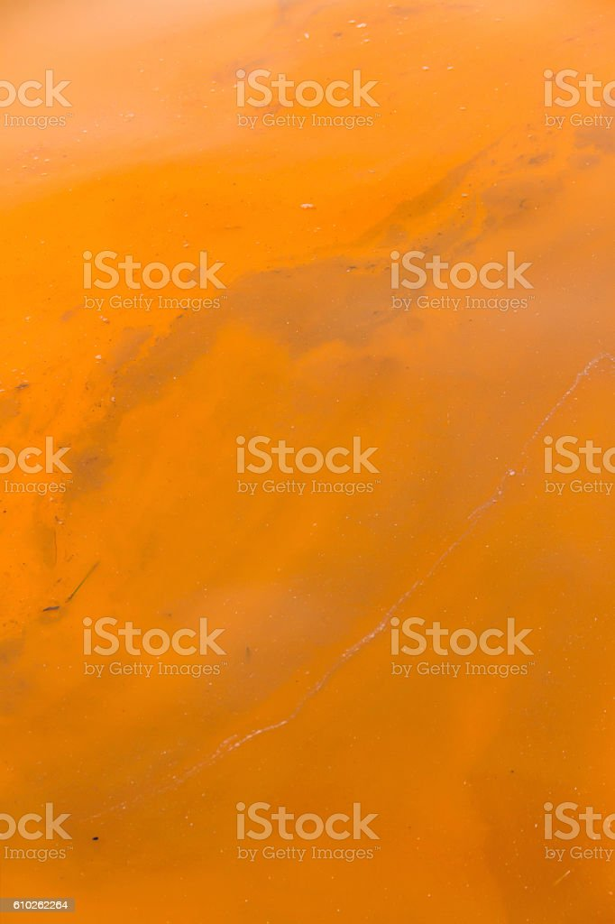 Orange Polluted Water stock photo
