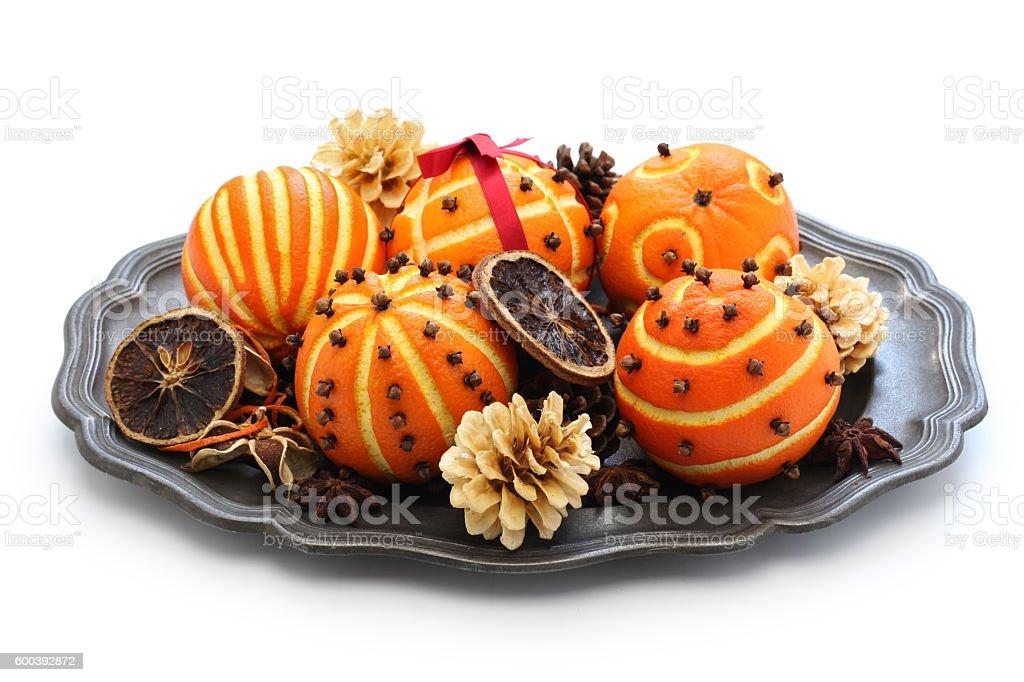 orange pomander balls, christmas table decoration stock photo
