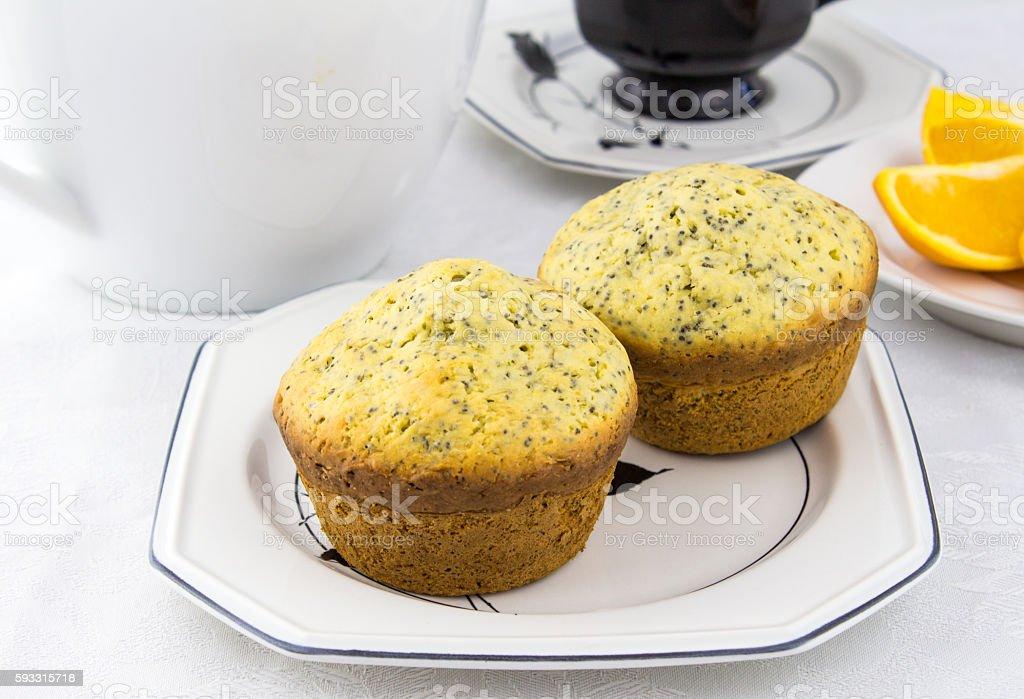 Orange poppy seed muffins on white plate stock photo
