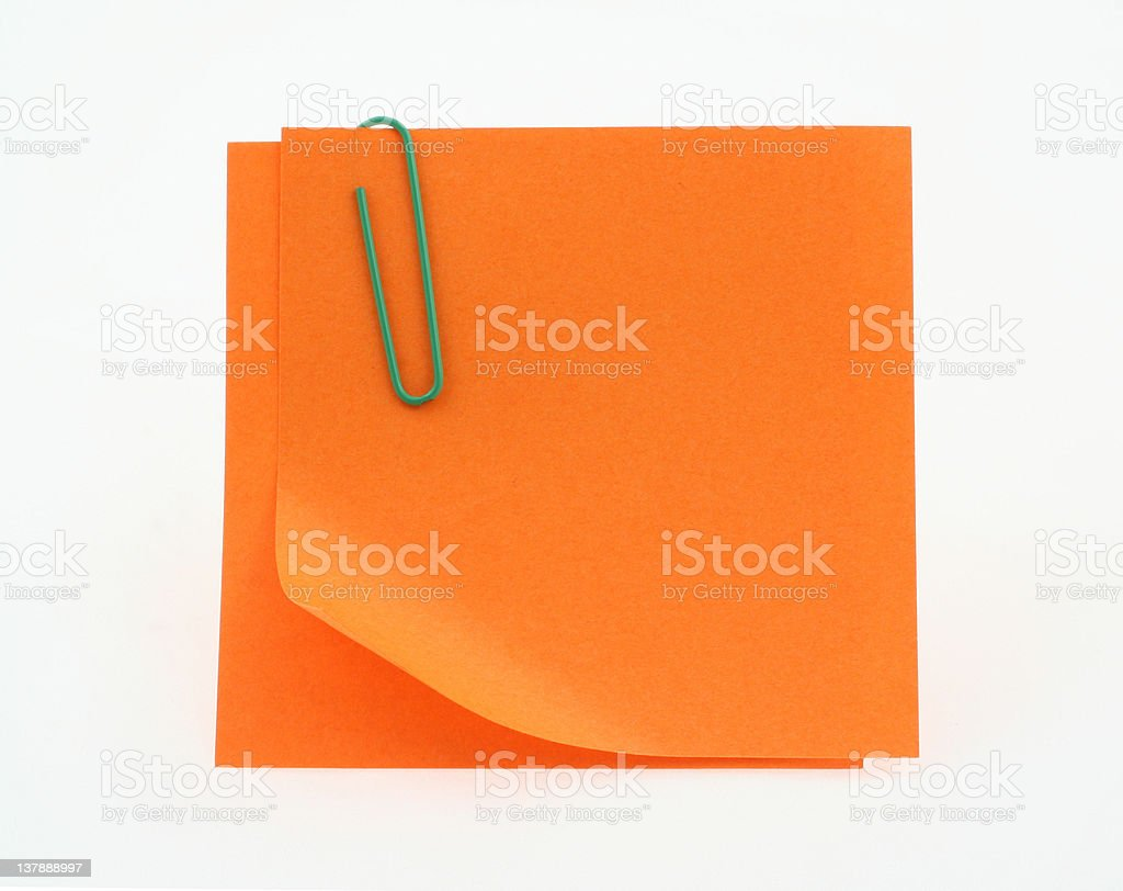 orange post-it notes with a bent corner on white stock photo