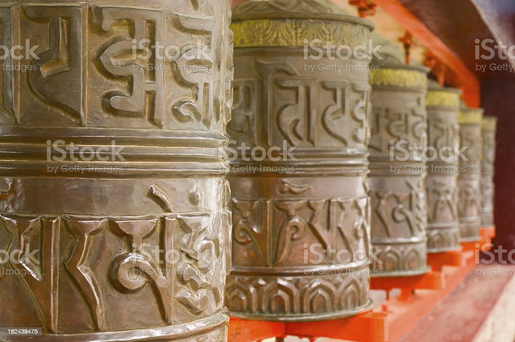 Orange prayer wheels royalty-free stock photo