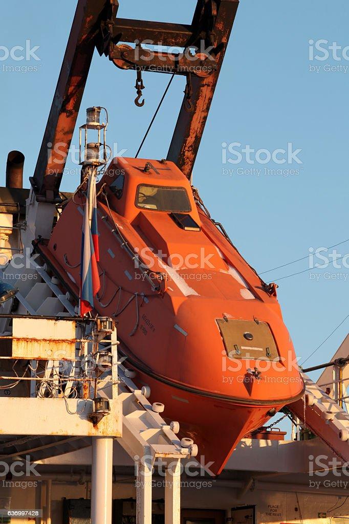 orange rescue boat slide stock photo