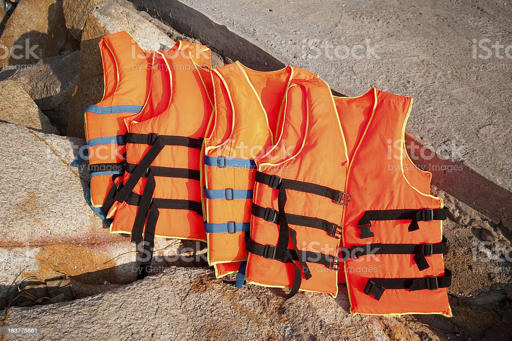 orange rescue jackets on the background of rocks royalty-free stock photo