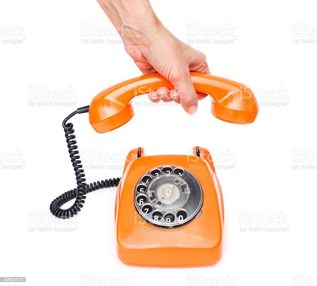 Orange retro telephone isolated on white background. stock photo