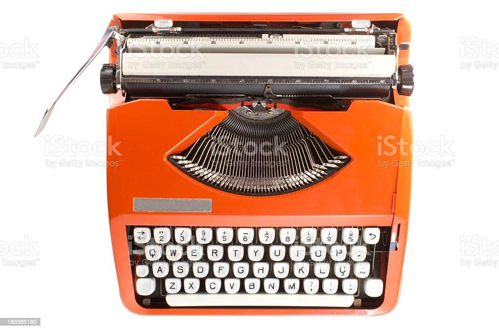 Orange retro typewriter with white keys stock photo