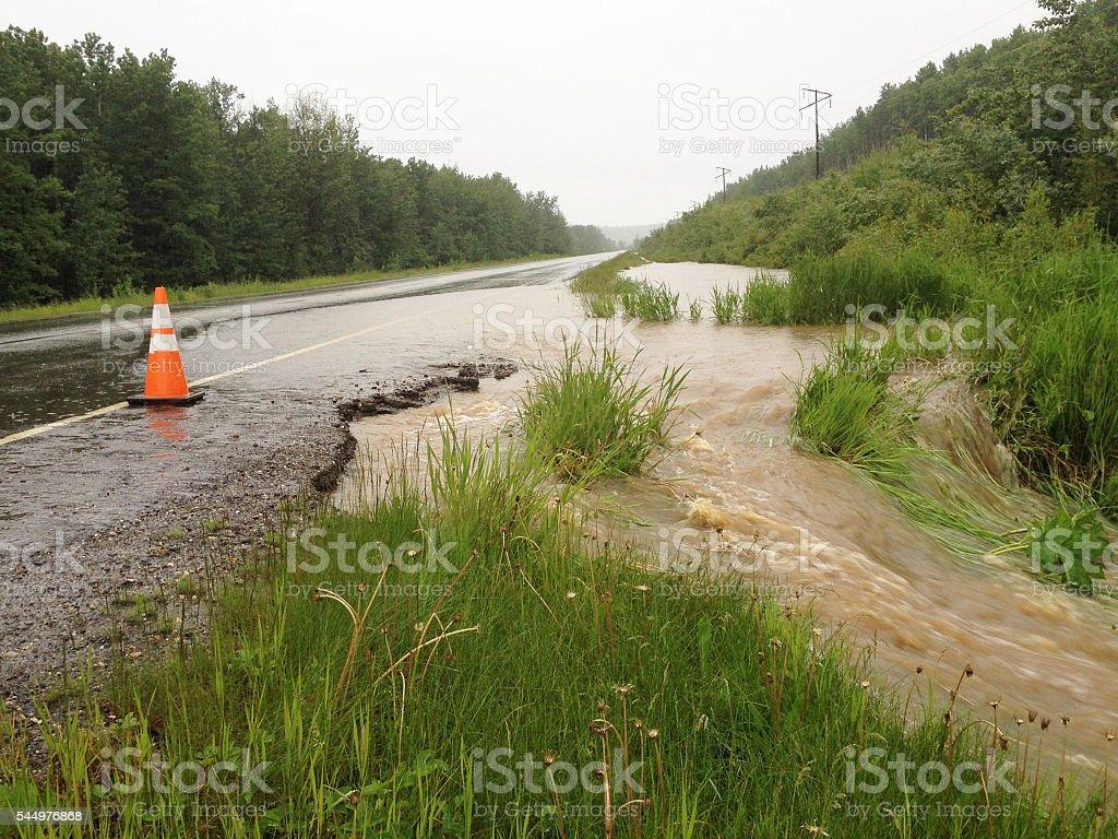 Orange Road Flood Danger Traffic Warning Cone Construction Highway Hazard stock photo