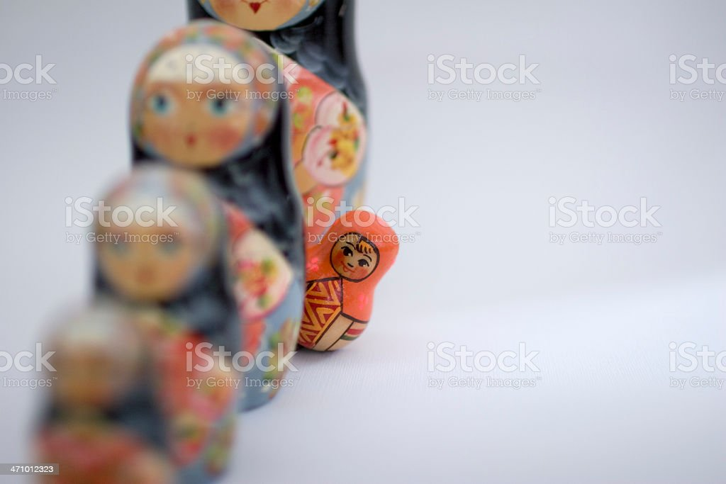 Orange Russian nesting doll, standing out stock photo