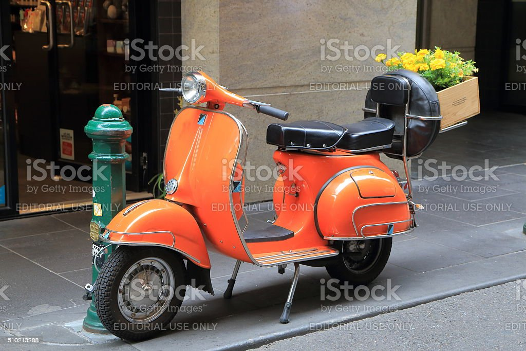 Orange scooter motorbike stock photo