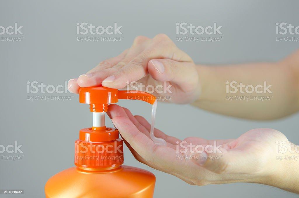 Orange Shampoo Bottle stock photo
