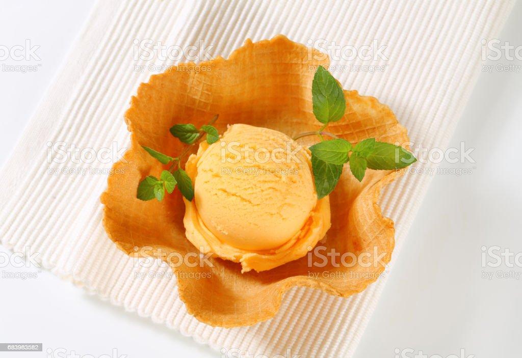 Orange sherbet in a waffle basket stock photo