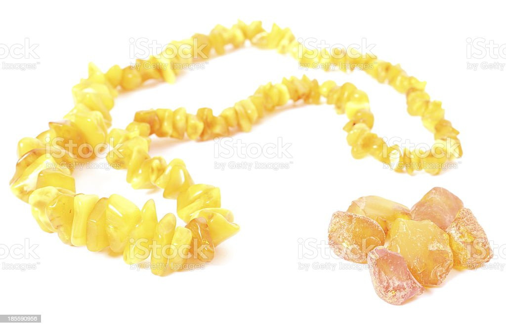 Orange, shiny necklace for the woman with raw amber royalty-free stock photo