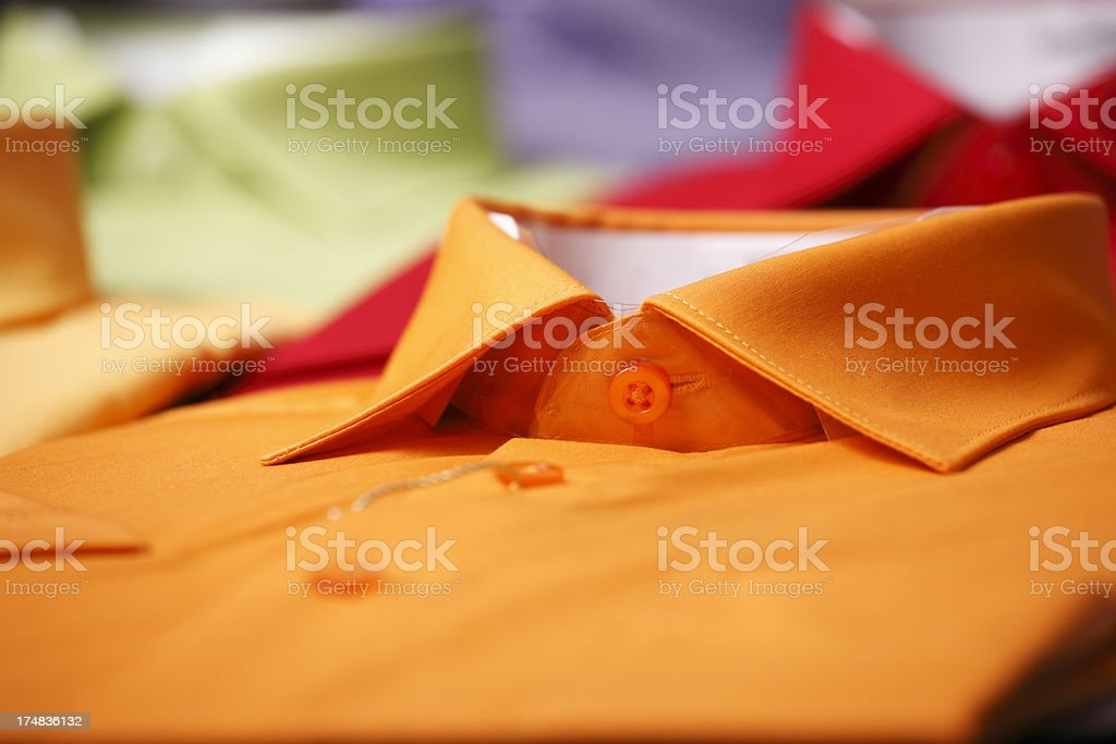 Orange  shirt in a store royalty-free stock photo