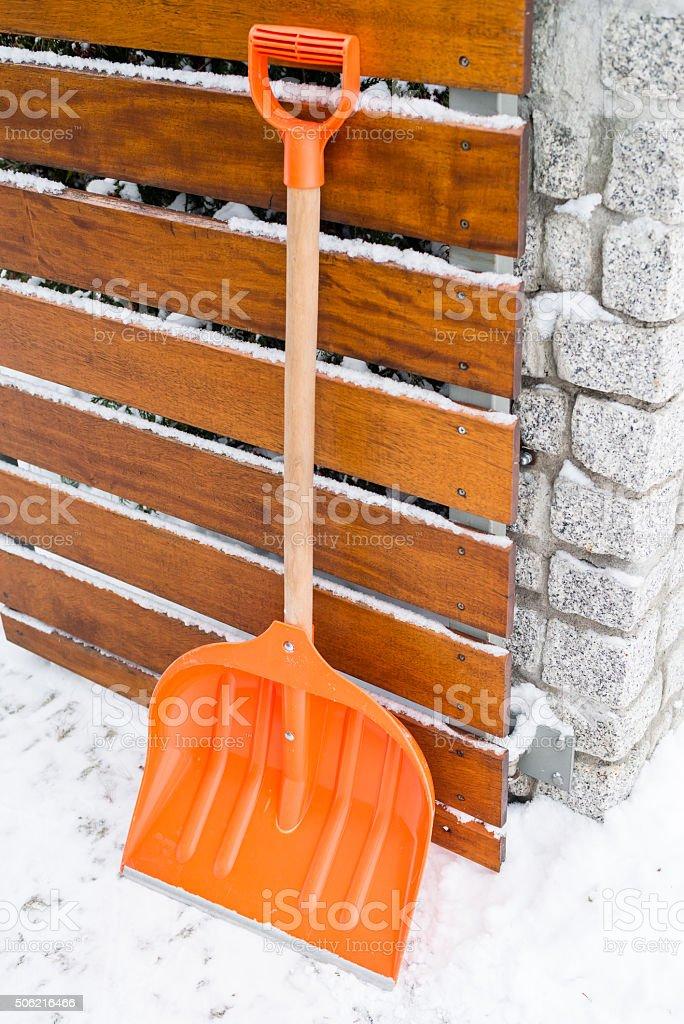 Orange shovel for snow removal stock photo