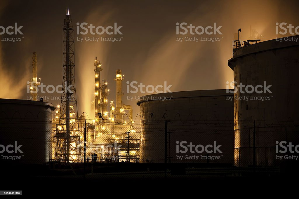 Orange Sky With Tanks and Refinery royalty-free stock photo