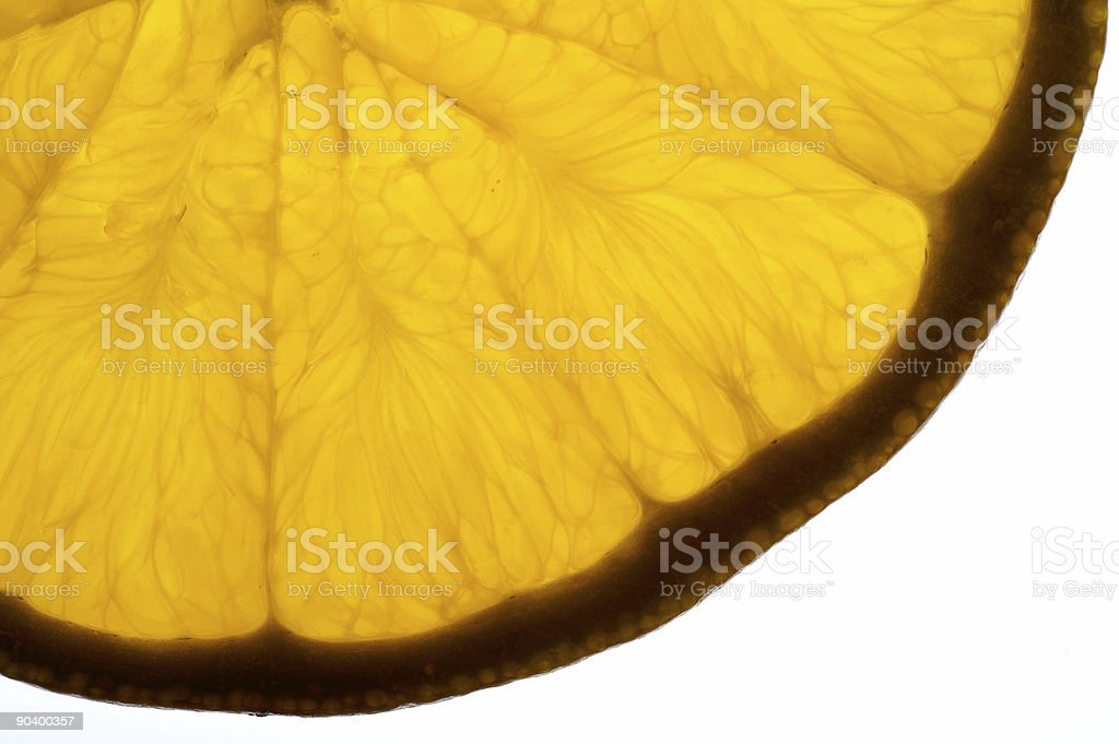 Orange slice backlighted background royalty-free stock photo