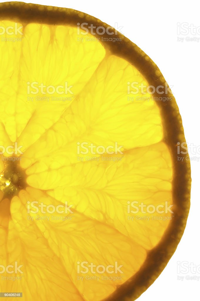 Orange slice on a light table (vertical back lighted) stock photo