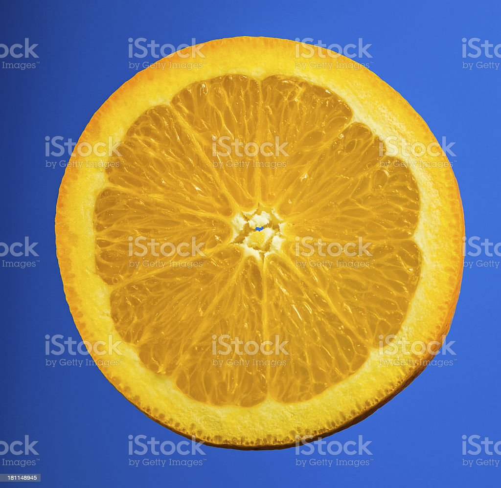 Orange slice on blue royalty-free stock photo