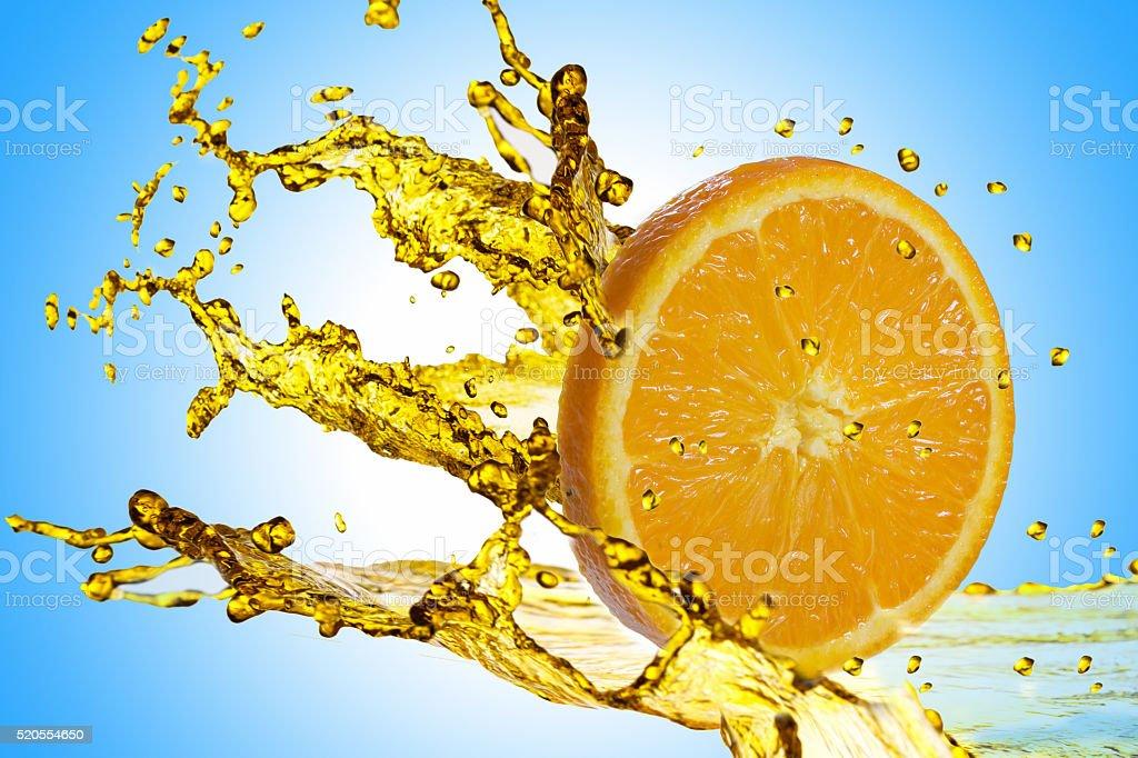 Orange slice splashing on white stock photo