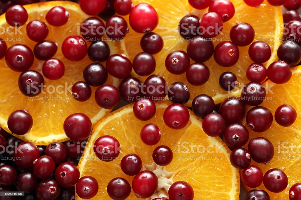 Orange slices and cranberries royalty-free stock photo