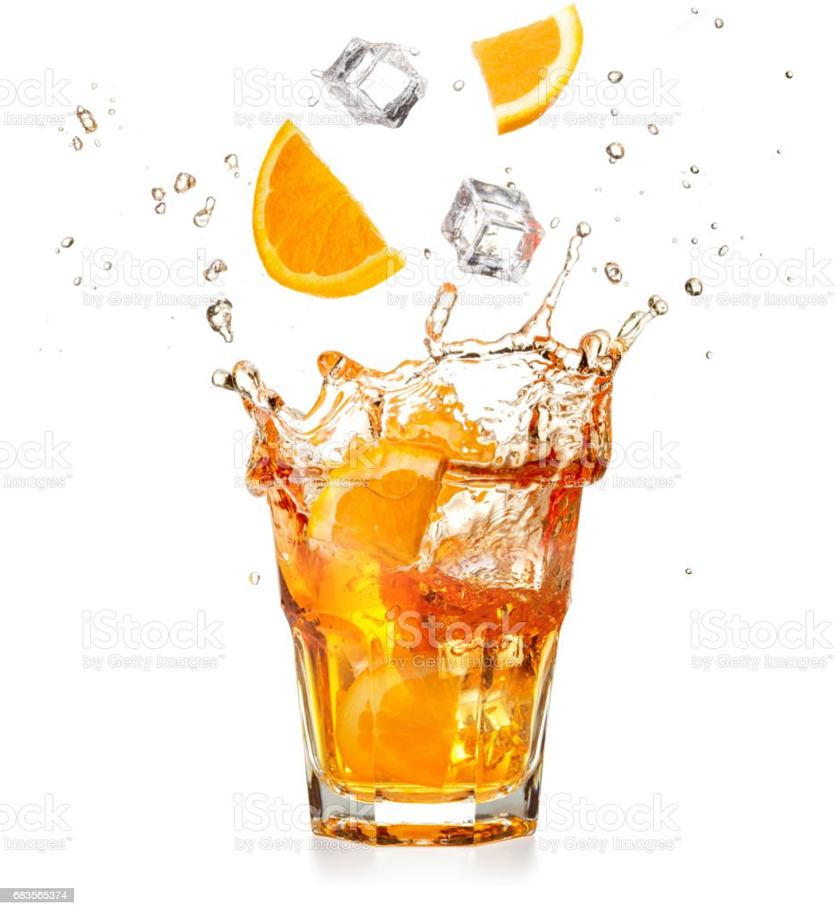 orange slices and ice cubes dropping into a splashing cocktail stock photo