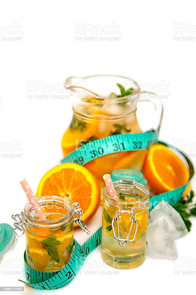 orange slices and ice cubes in jar stock photo