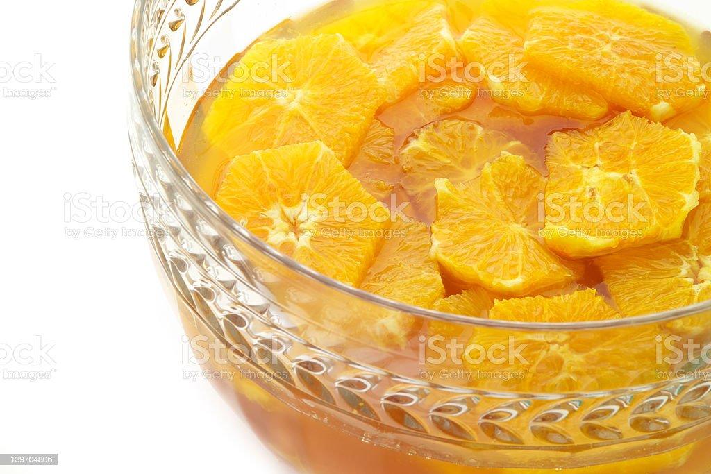 Orange slices marinading in a crystal bowl stock photo