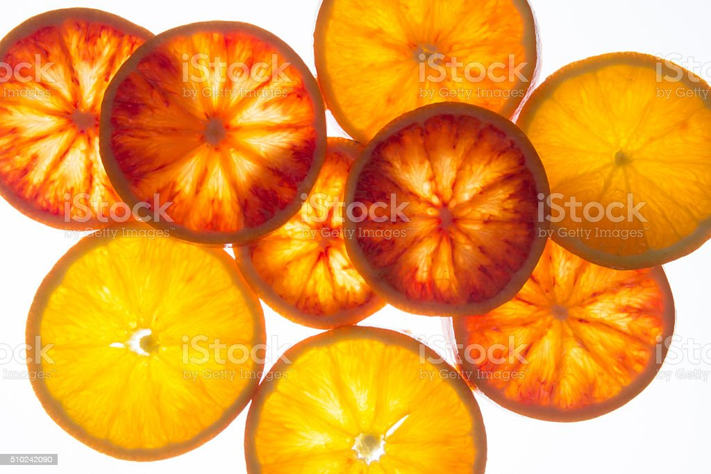 Orange slices with back light, flat layout, top view. stock photo