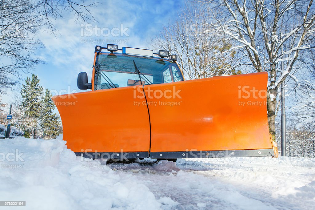 Orange snowplough stock photo