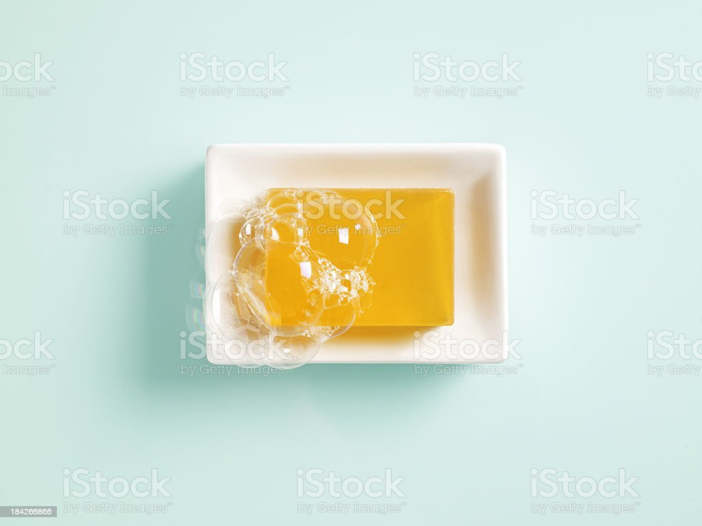 Orange soap in a dish stock photo