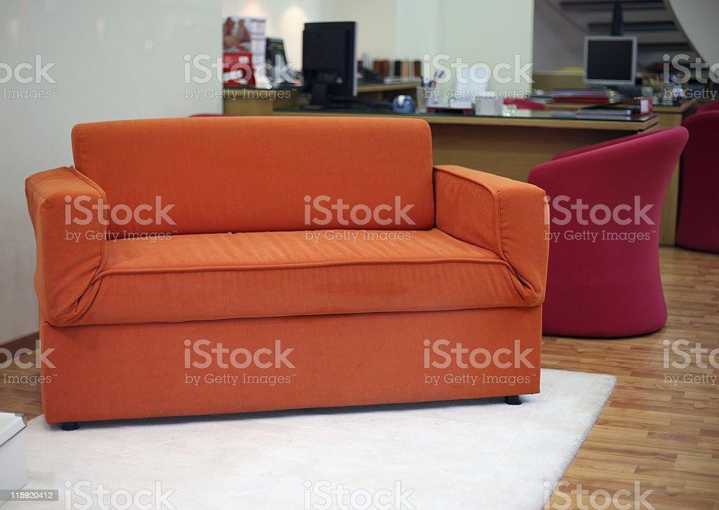 Orange sofa royalty-free stock photo