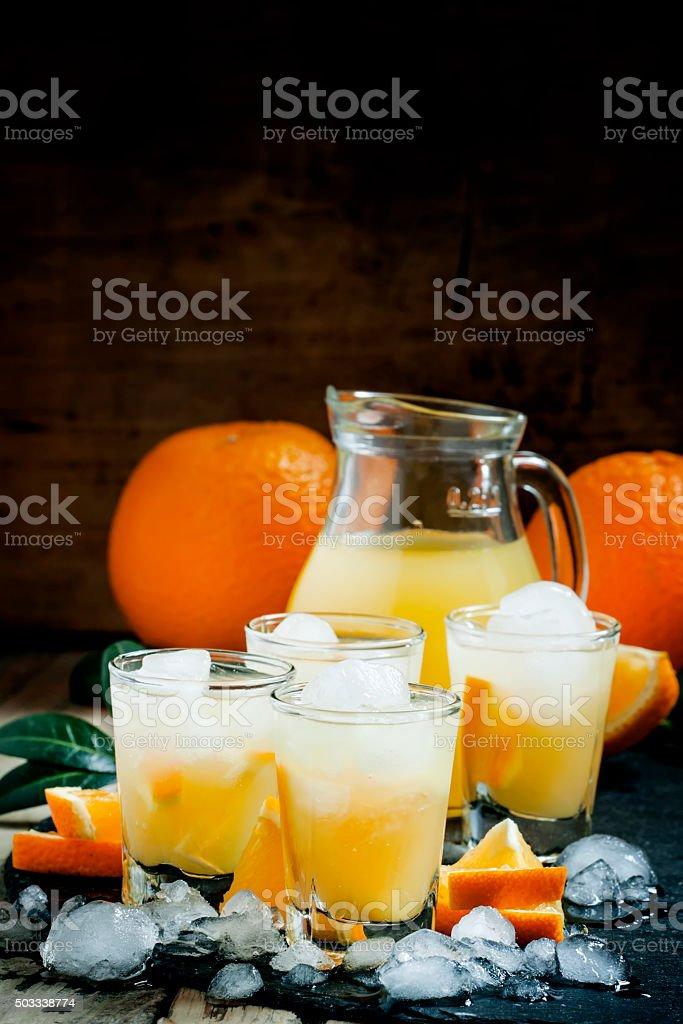 Orange soft drink with juice, vodka and ice stock photo