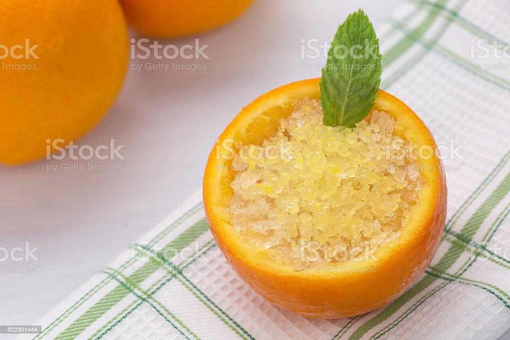 Orange sorbet in orange skin stock photo