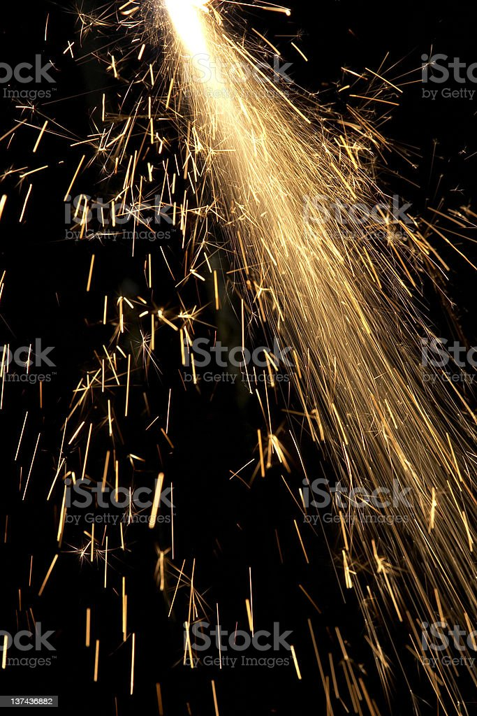 Orange sparks flying from cutting metal royalty-free stock photo