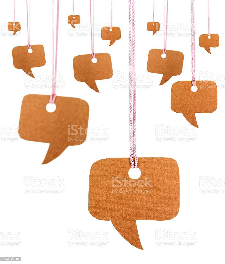 Orange speech bubbles hanging on white royalty-free stock photo