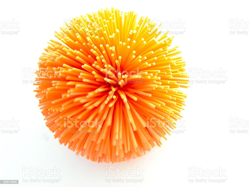 Orange spiked ball with white background stock photo