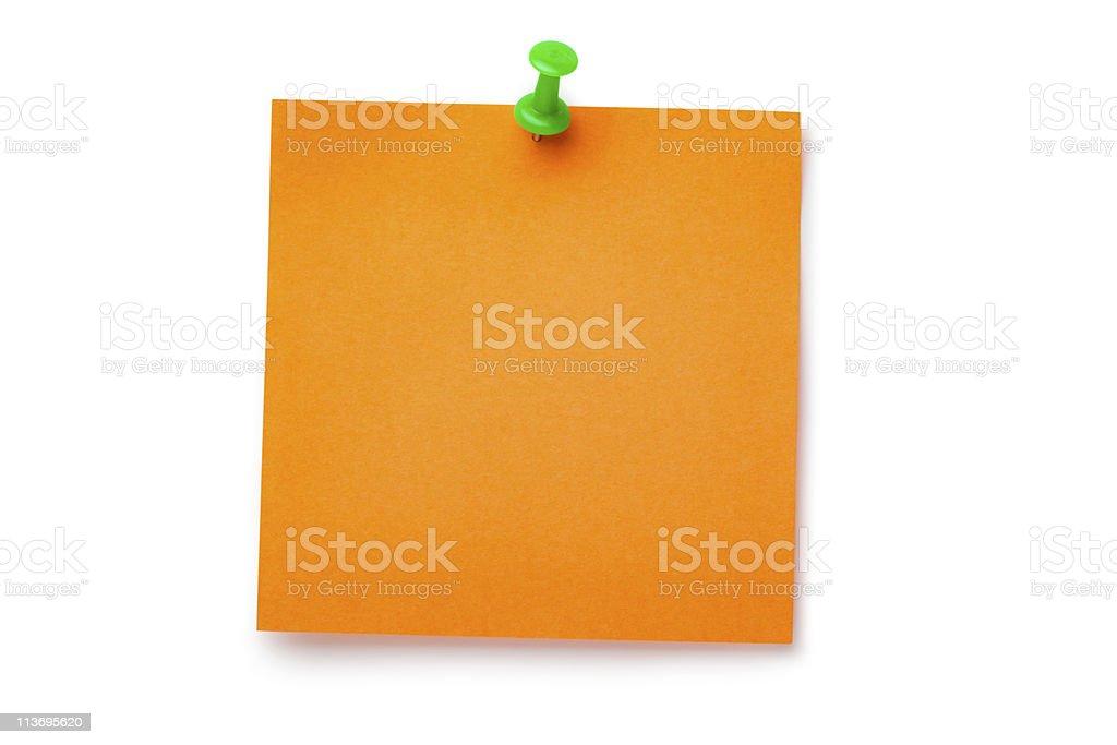 Orange sticker on green thumbtack royalty-free stock photo