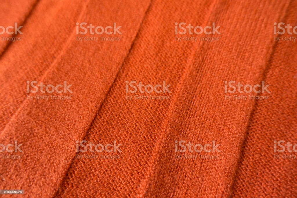 Orange stockinet fabric with wide relief stripes stock photo