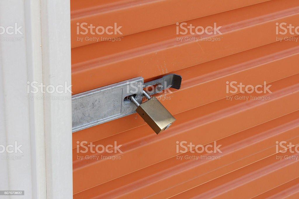 Orange Storage Door With Padlock stock photo