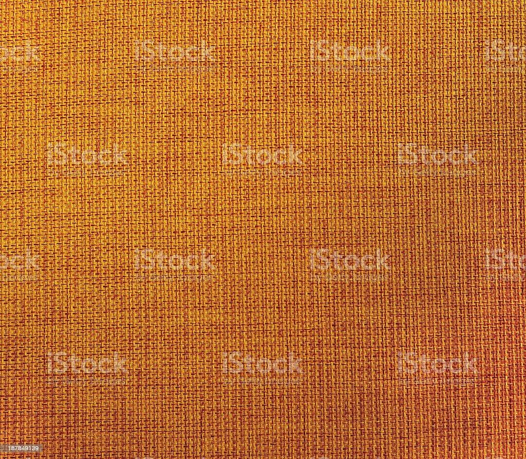 orange striped fabric as background royalty-free stock photo
